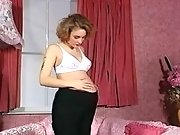 Pregnant beauty relaxes in bedroom
