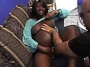 Pregnant ebony sucks cock on sofa