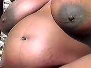 Pregnant ebony sucks cock outdoor