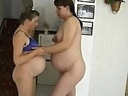 Pregnant lesbians have fun on floor